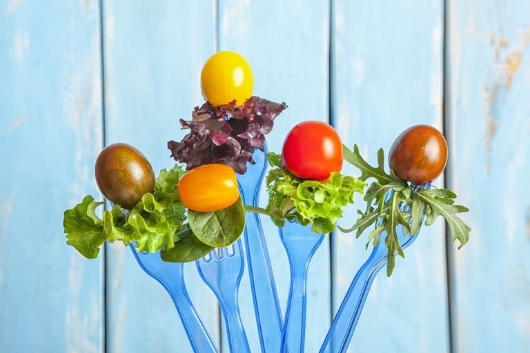 Varieties of cherry tomatoes in blue plastic fork
