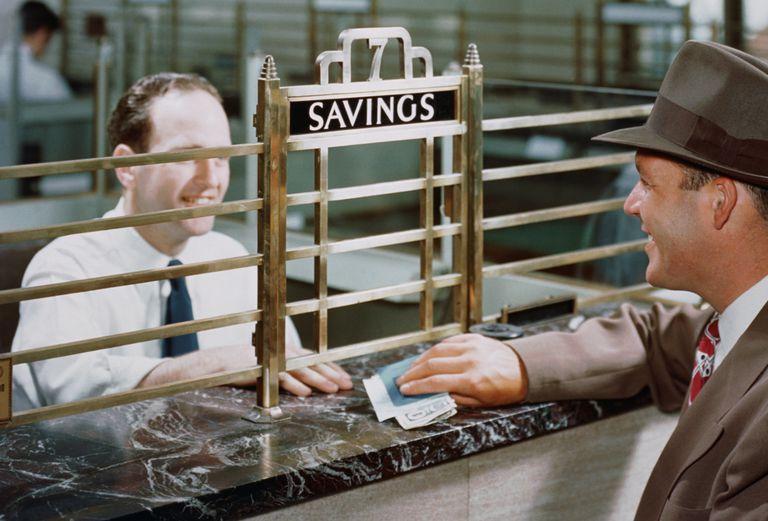 Bank teller and savings account customer