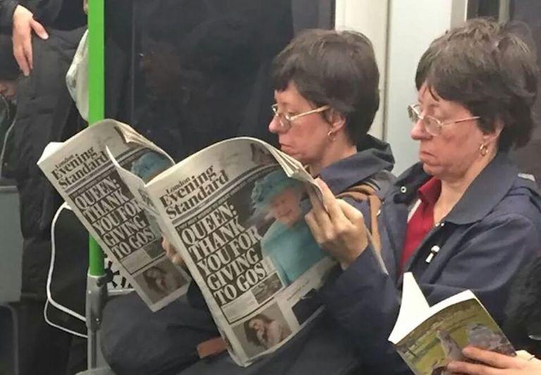 matching ladies reading newspaper