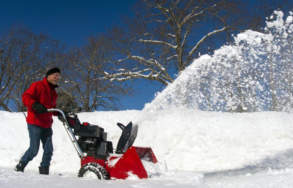 Image of man using gas snowblower in Damariscotta, Maine.