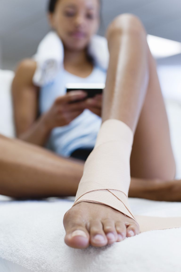 Woman with bandage on ankle, low angle view