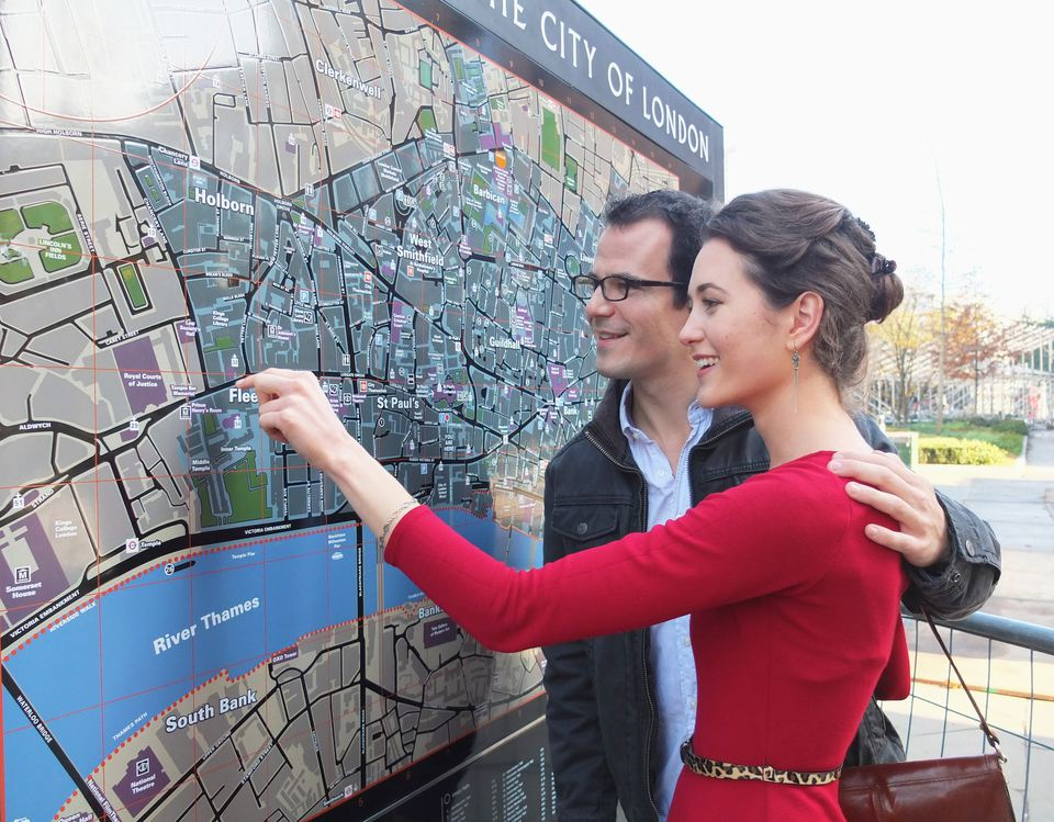 Couple reading London city map