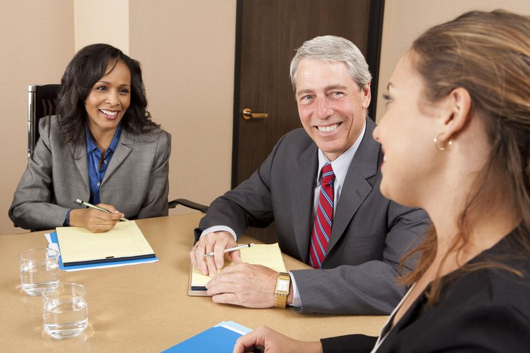 Employees participate in a second job interview to get to know the candidate.