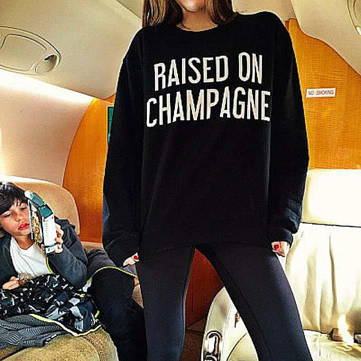"""A photo posted to Rich Kids of Instagram shows a girl wearing a sweatshirt that reads """"Raised on Champagne."""" Symbolic interaction theory helps us understand how this shirt and the photo of it create meaning in society."""