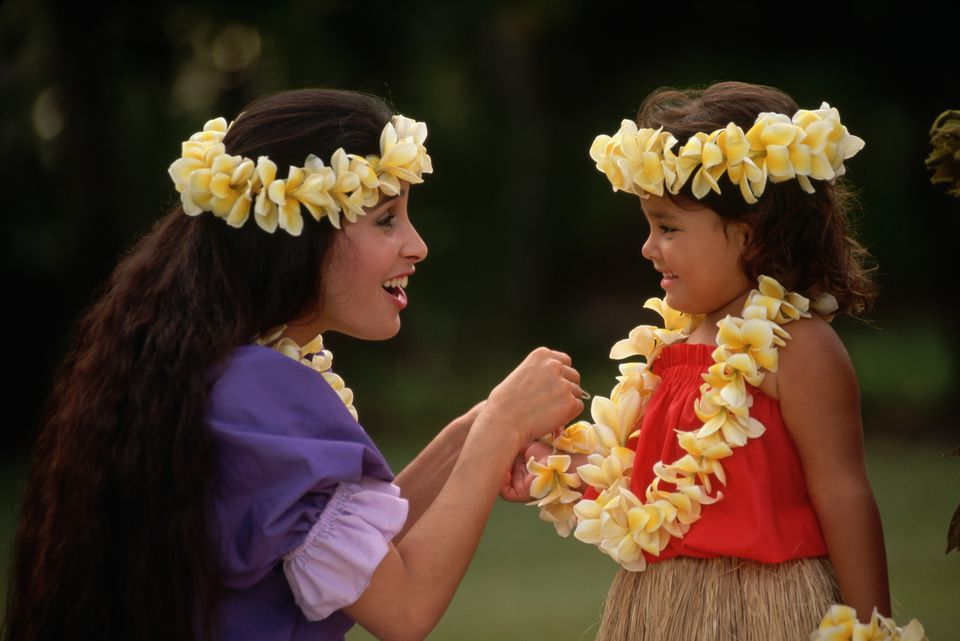 Hawaiian Woman and Girl Wearing Yellow Flowers