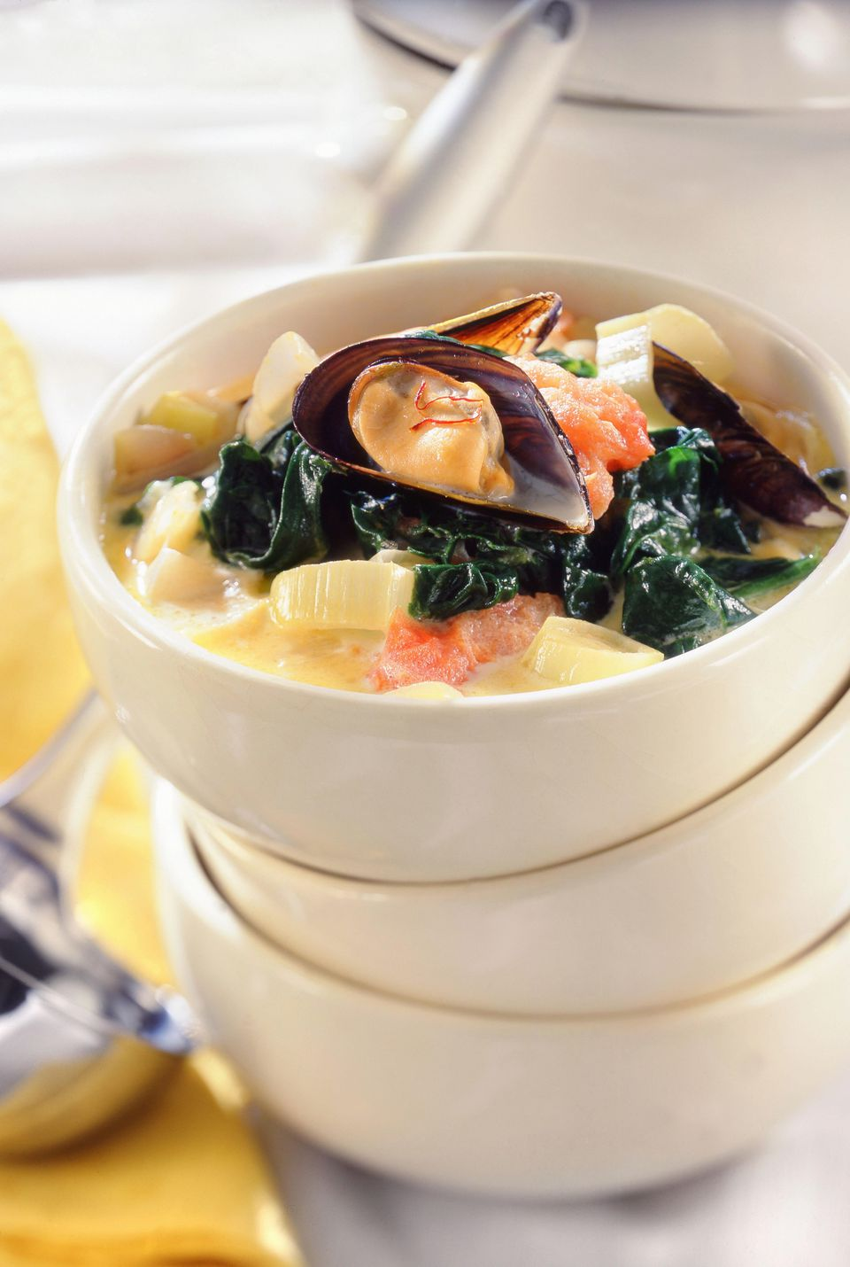 Fish stew with mussels, spinach and saffron
