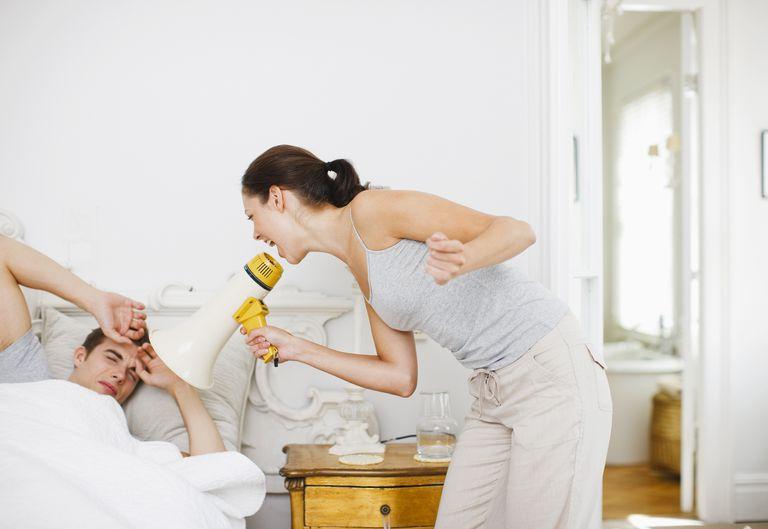 woman waking up a man