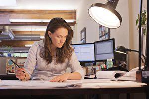 Businesswoman studies paperwork