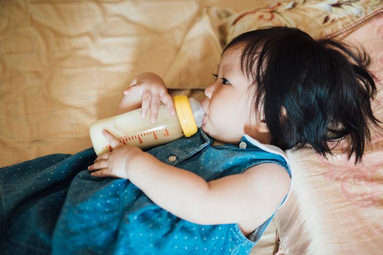 Baby drinking milk from bottle