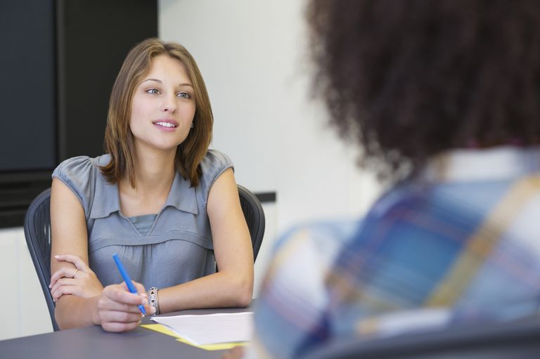 Businesswoman taking an interview of an African American woman