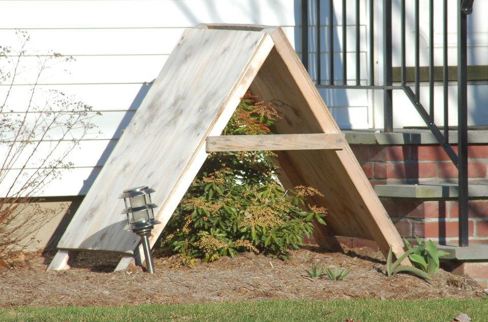 Commercial shrub shelter, consisting of an A-frame roofed with plywood.