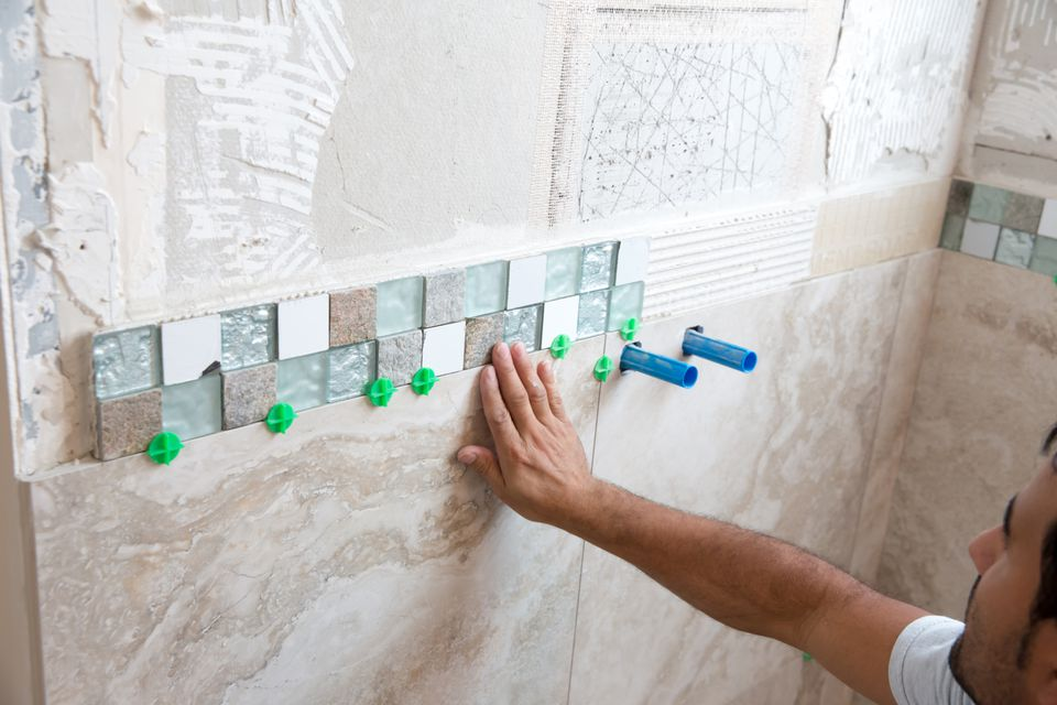 How to tile a shower How to put tile on wall in the kitchen