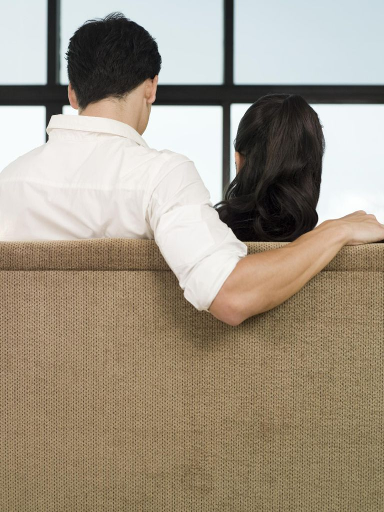 Rear view of couple on sofa