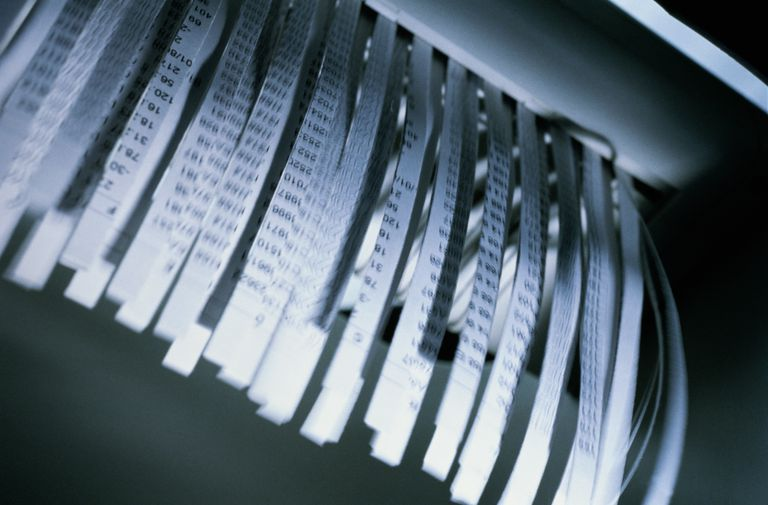 Document emerging from paper shredder