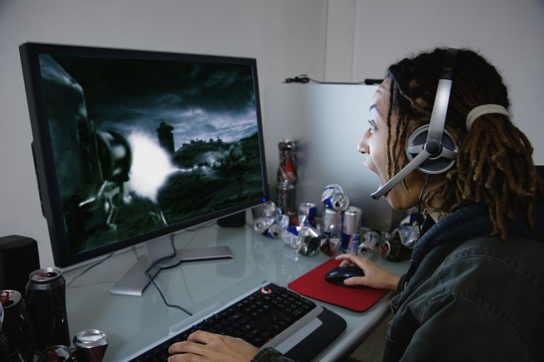 Figure 1-1: A screen shot of a woman playing a computer game and winning.