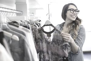 woman looking at clothing in a store