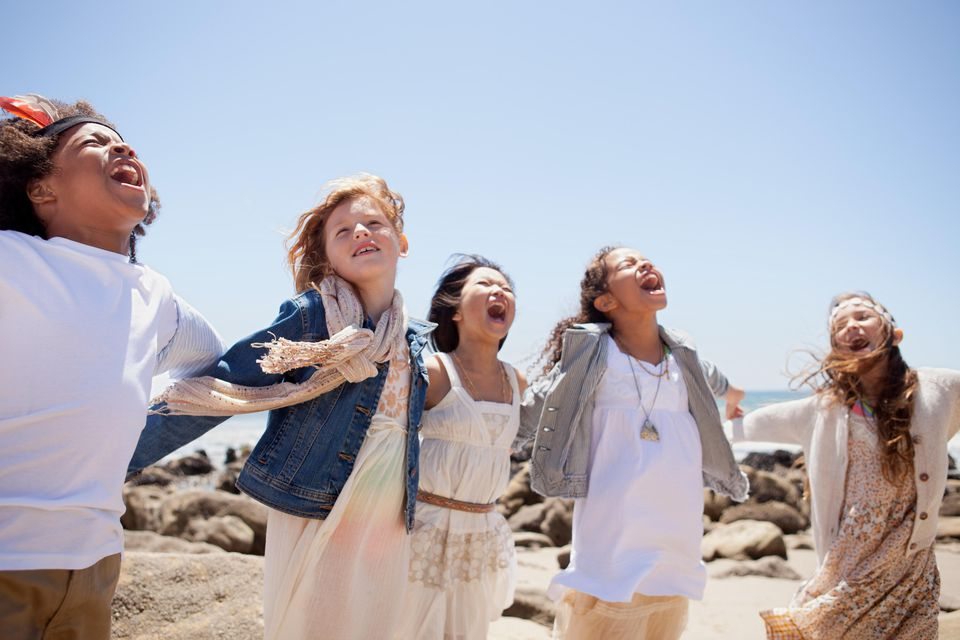 Children singing together at the coast