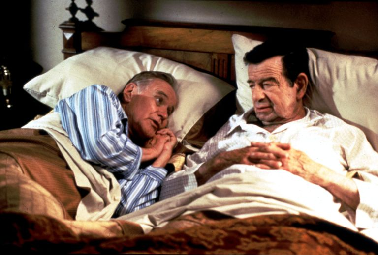 The Odd Couple, Jack Lemmon and Walter Matthau, work out their differences in bed