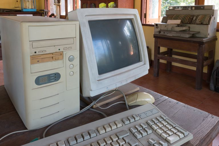 An old desktop computer with a CRT monitor.