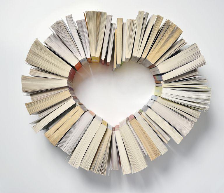 paperback books arranged in heart shape