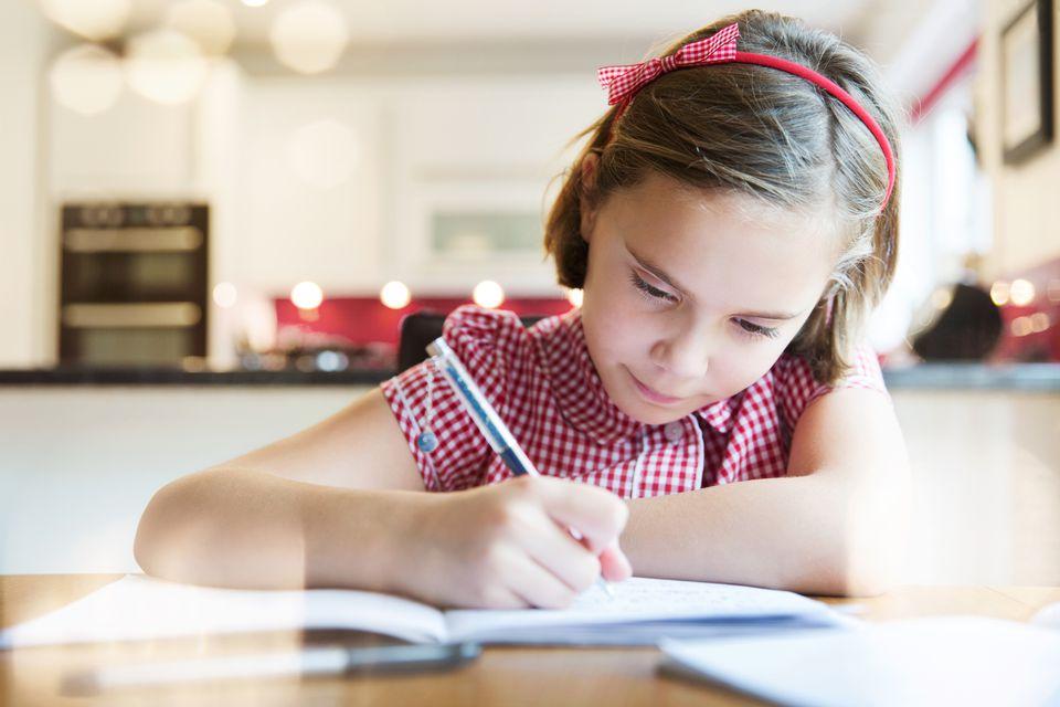 girl writing at table