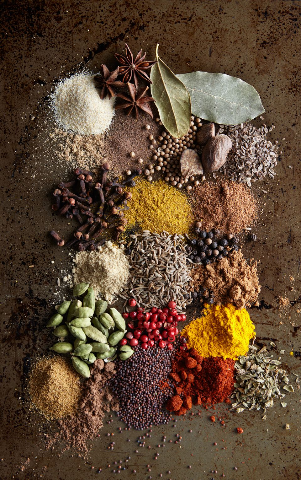Piles of Various spices on metal surface