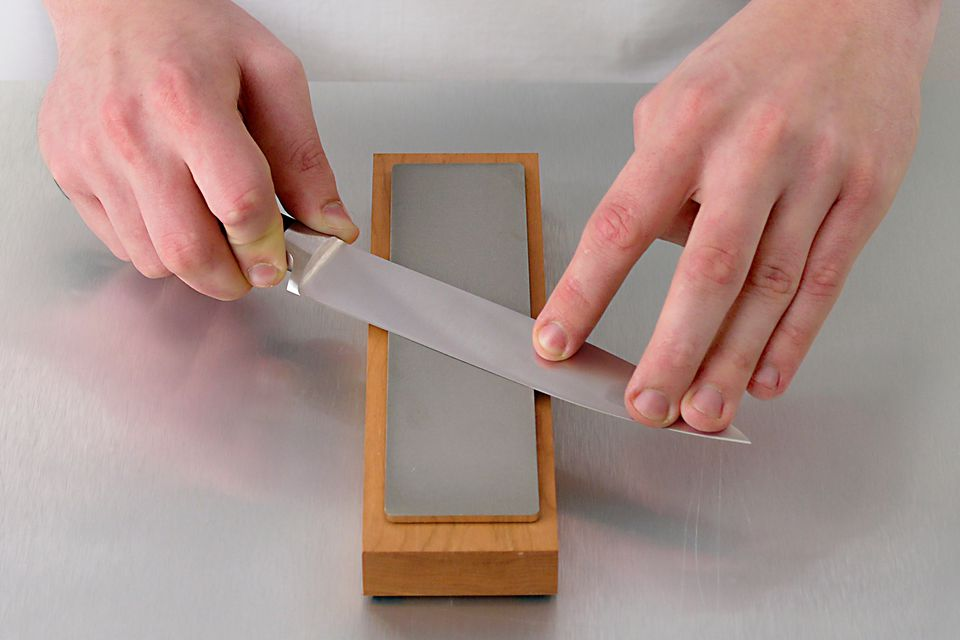 Sharpening a knife with a whetstone