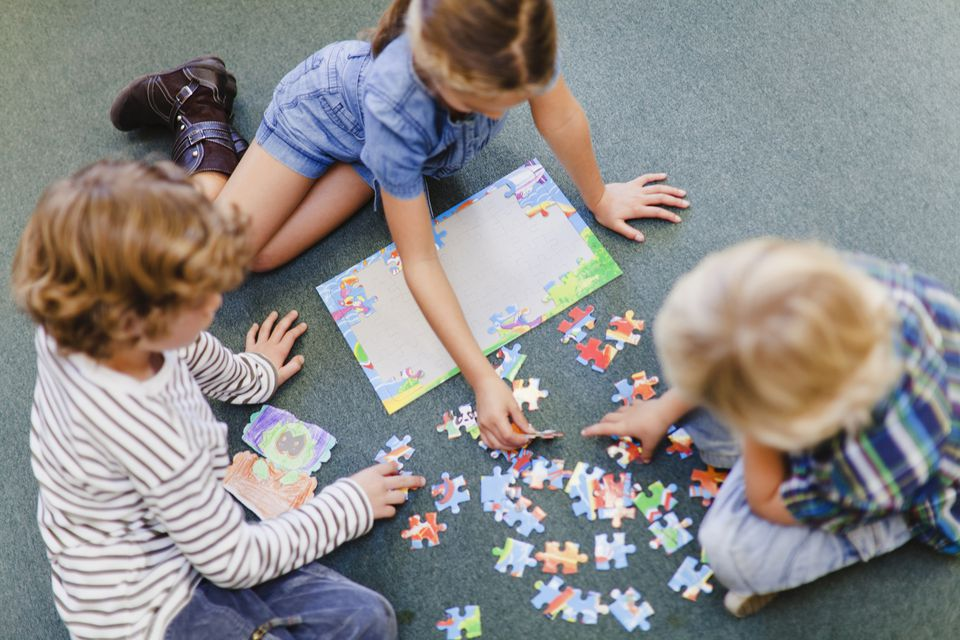 Children doing a puzzle together