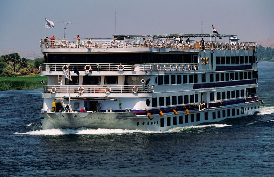 A cruise ship moving at full speed on the Nile River.