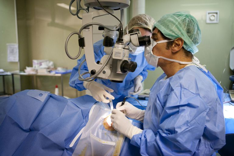 France, Surgeon during operation for glaucoma treatment