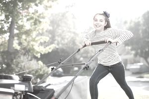 Girl mowing lawn