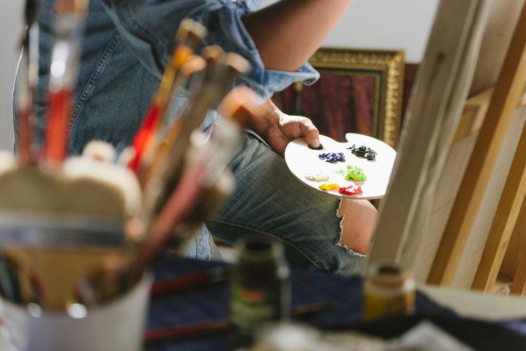 Chinese artist painting in studio