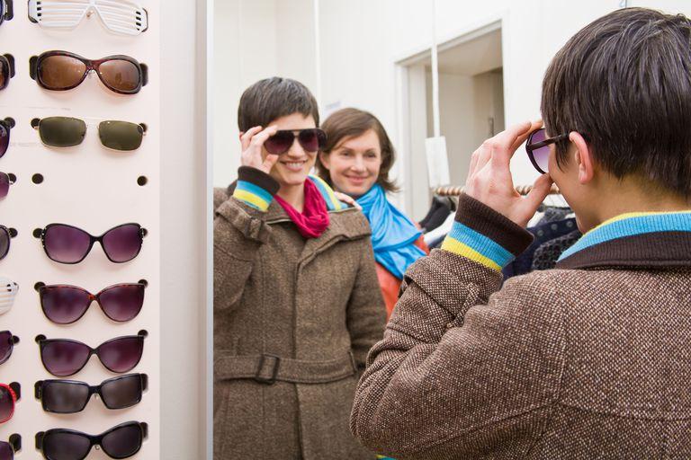 Women buying sunglasses