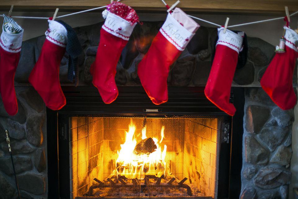 Christmas stockings hanging over fireplace