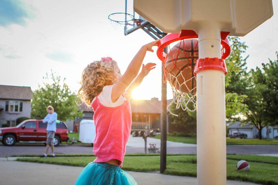 Young girl playing basketball