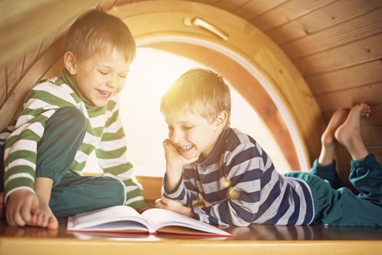 Little boys having fun reading.