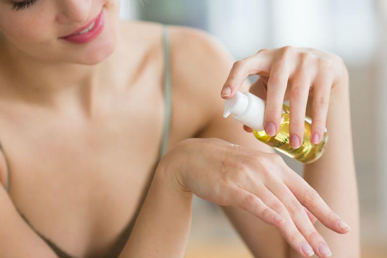 Woman applying sweet almond oil