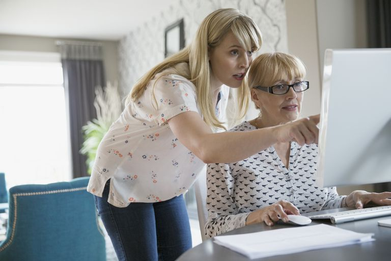 Mother and Daughter using a computer
