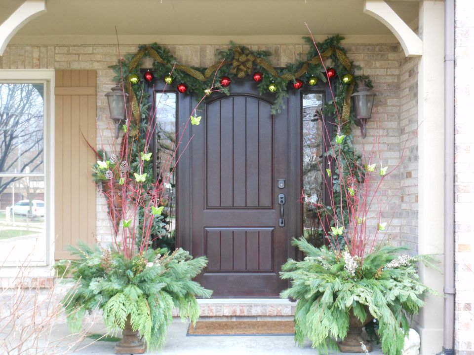 Lush Christmas Urns on porch