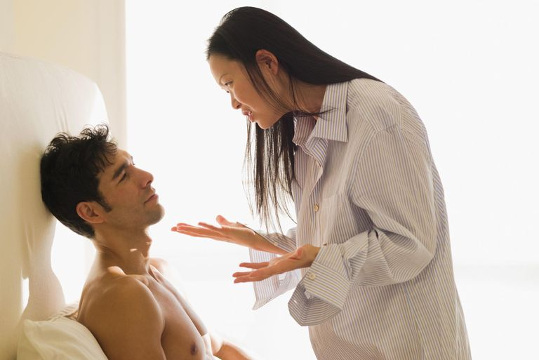 Woman arguing with a man in the bedroom