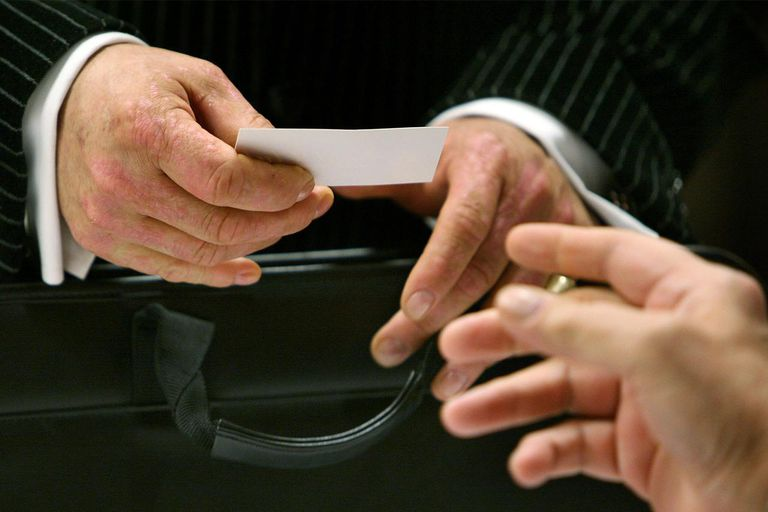 Handing a business card to someone else