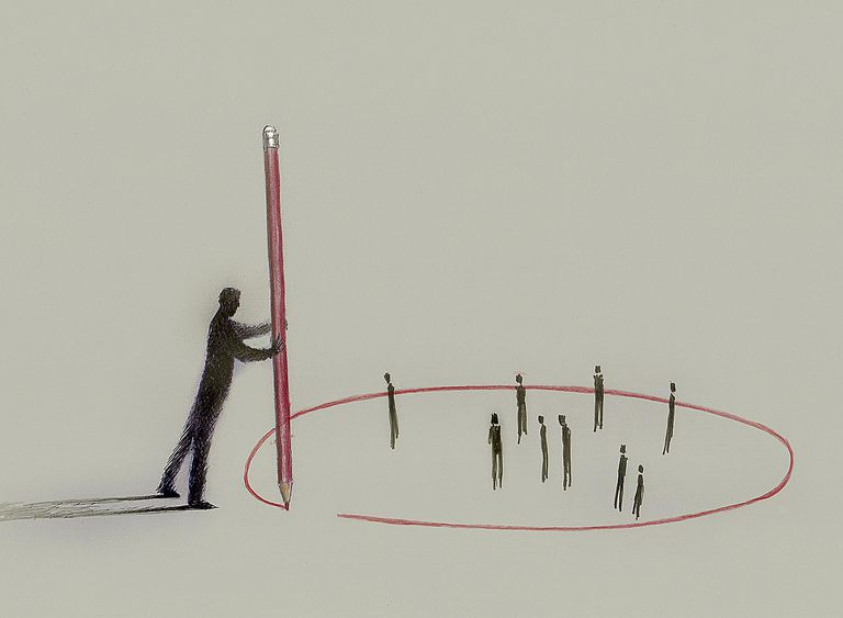 A man drawing a circle around a group of people symbolizes the concept of social oppression.