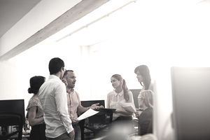 Shot of a group of coworkers talking together in an office
