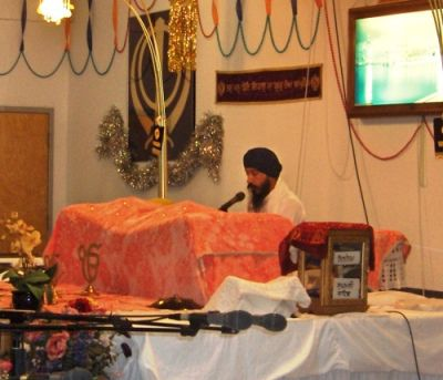Reciting the Hymn of Anand Sahib