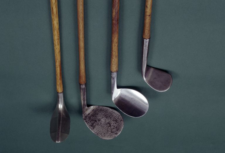 Four antique golf clubs including two niblicks