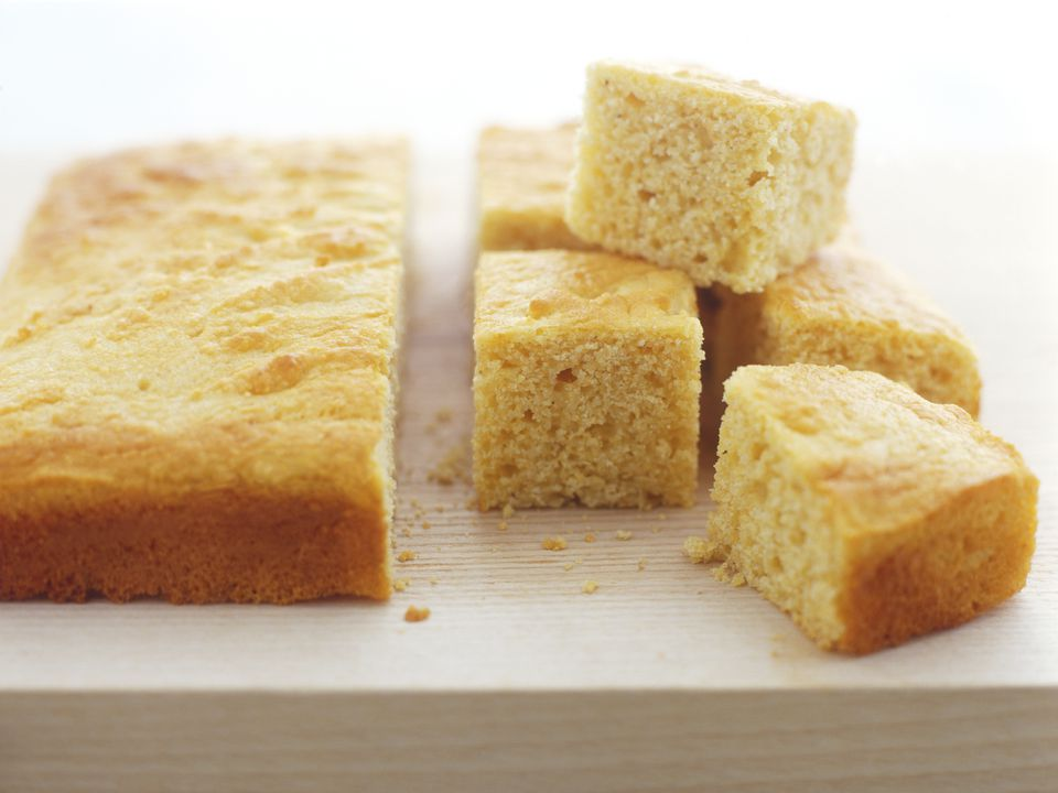 Buttermilk Cornbread cut into bite-size pieces, on a wooden chopping board