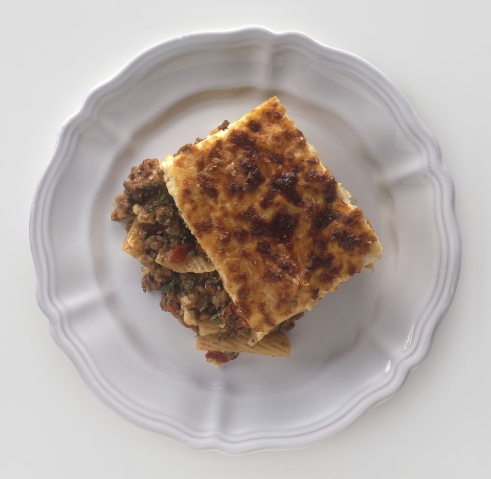 Pastitsio, Greek macaroni, meat and tomato dish baked with bechamel sauce, served on a plate, view from above