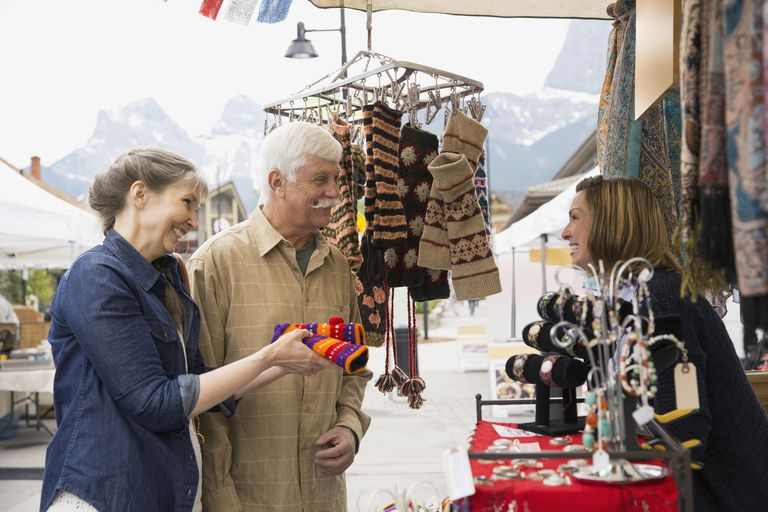 Older couple shopping at outdoor market