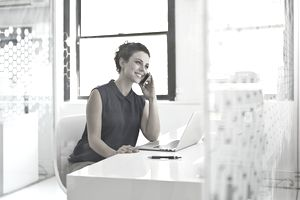 Business woman on phone in office