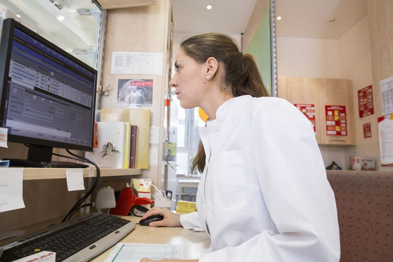 female pharmacist using computer
